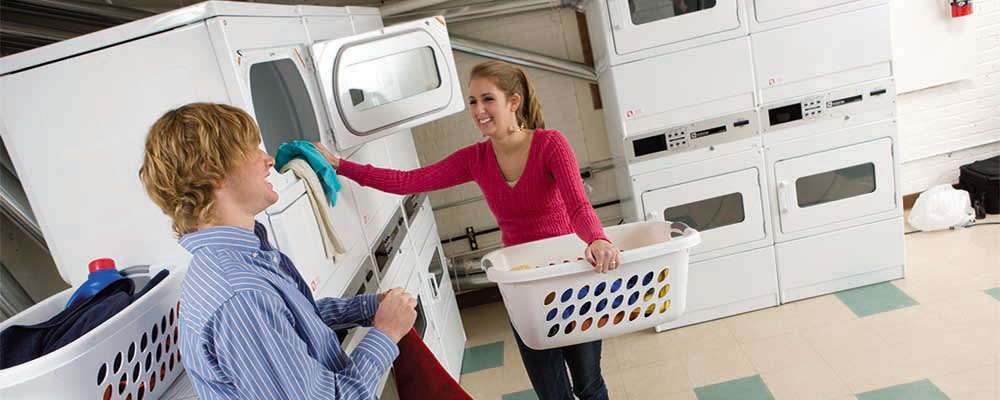 Stack washers & dryers with coin receiver